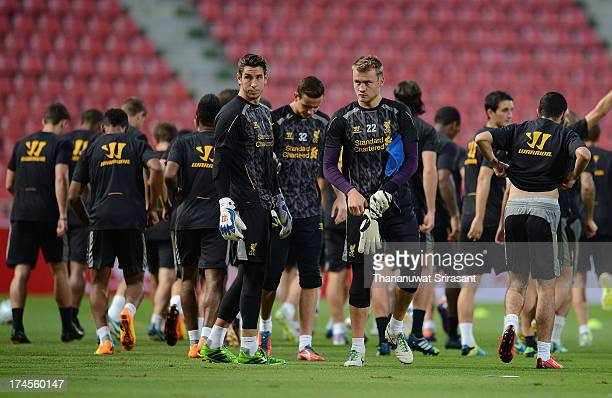 Danny Ward and Simon Mignolet goalkeepers of Liverpool FC attend a Liverpool FC training session at Rajamangala Stadium on July 27 2013 in Bangkok...