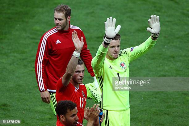 Danny Ward Gareth Bale and Wayne Hennessey of Wales celebrate their team's 30 win in the UEFA EURO 2016 Group B match between Russia and Wales at...