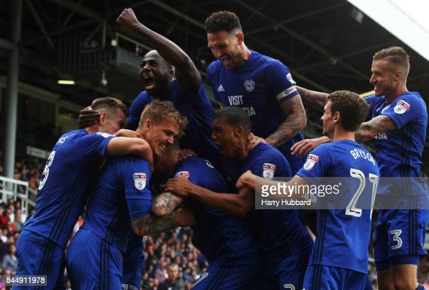 Danny Ward of Cardiff City celebrates scoring with team mates during the Sky Bet Championship match between Fulham and Cardiff City at Craven Cottage...