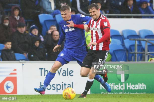 Danny Ward of Cardiff City challenges Andreas Bjelland of Brentford during the Sky Bet Championship match between Cardiff City and Brentford at the...