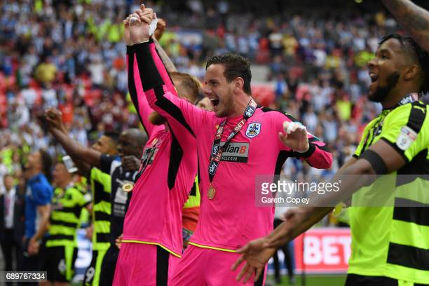 Danny Ward of Huddersfield Town celebrates promotion to the Premier League with his Huddersield Town team mates after the Sky Bet Championship play...