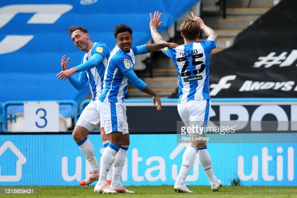 Danny Ward of Huddersfield Town celebrates with team mates after scoring their side's first goal during the Sky Bet Championship match between...