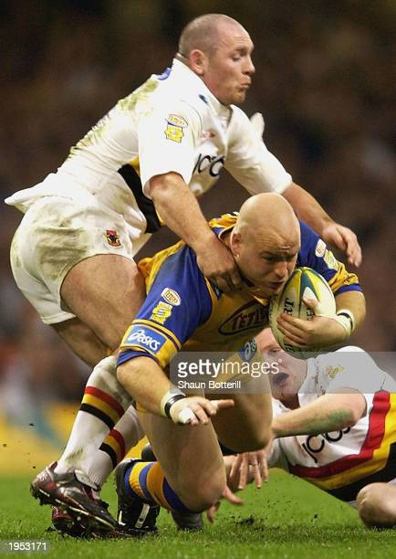 Danny Ward of Leeds Rhinos is tackled by the Bradford defence during the Powergen Challenge Cup Final 2003 match between Bradford Bulls and Leeds...