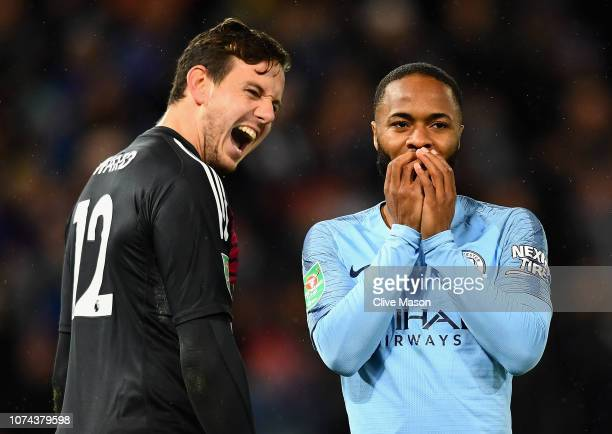 Danny Ward of Leicester City celebrates as Raheem Sterling of Manchester City looks dejected after missing his team's second penalty during a penalty...