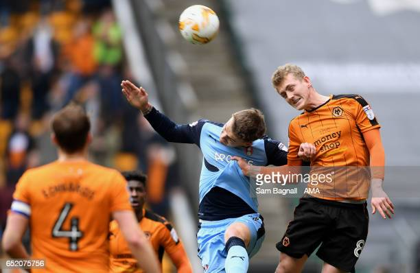 Danny Ward of Rotherham United and George Saville of Wolverhampton Wanderers during the Sky Bet Championship match between Wolverhampton Wanderers...
