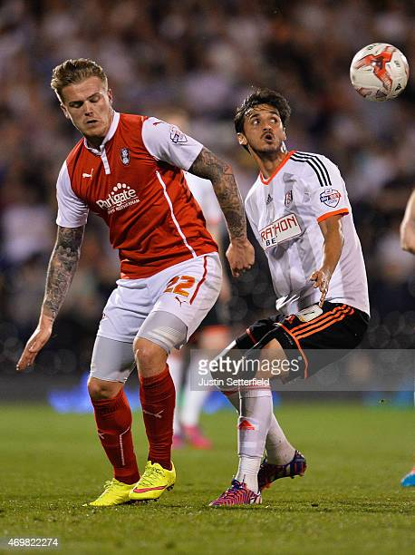 Danny Ward of Rotherham United battles with Bryan Ruiz of Fulham during the Sky Bet Championship match between Fulham and Rotherham United at Craven...