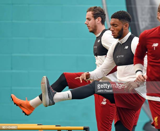 Danny Ward with Joe Gomez of Liverpool during a training session at Melwood Training Ground on March 13 2018 in Liverpool England