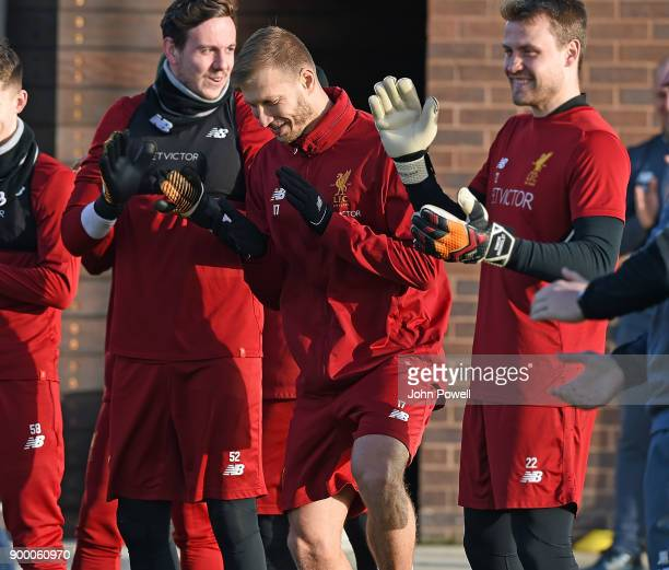 Danny Ward with Ragnar Klavan and Simon Mignolet of Liverpool during a training session at Melwood Training Ground on December 31 2017 in Liverpool...
