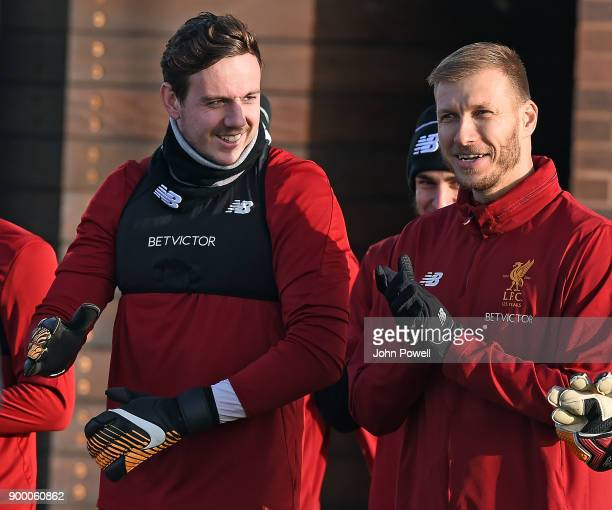 Danny Ward with Ragnar Klavan of Liverpool during a training session at Melwood Training Ground on December 31 2017 in Liverpool England
