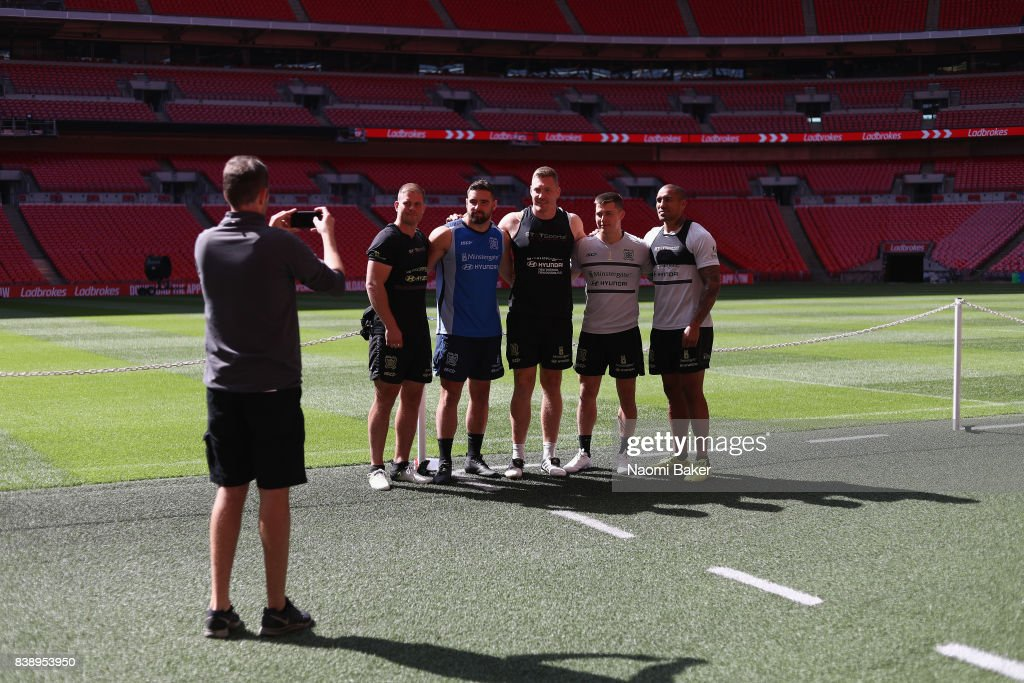 Danny Washbrook, Josh Bowden, Chris Green, Jamie Shawl and Fetuli Talanoa pose for a photograph during the Hull FC Captain's Run at Wembley Stadium on August 25, 2017 in London, England.
