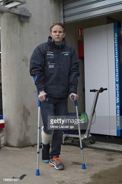 Danny Webb of Great Britain and Ambrogio Racing walks on crutches before the Moto3 race during the MotoGP of France on May 19 2013 in Le Mans France
