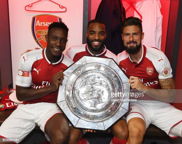Danny Welbeck Alex Lacazette and Olivier Giroud with the Community shield in the Arsenal changing room after the FA Community Shield match between...