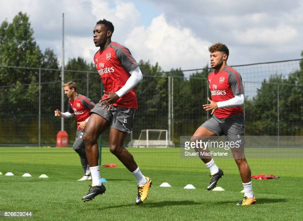 a0c843fbb4d300 Danny Welbeck and Alex OxladeChamberlain of Arsenal during a training  session at London Colney on August