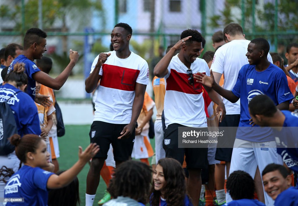 Danny Welbeck and Daniel Sturridge (R) of England laugh during a visit to Complexo Esportivo da Rocinha on June 9, 2014 in Rio de Janeiro, Brazil.