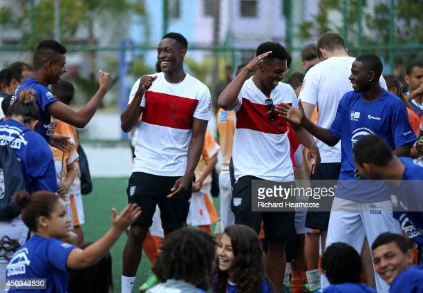 Danny Welbeck and Daniel Sturridge of England laugh during a visit to Complexo Esportivo da Rocinha on June 9 2014 in Rio de Janeiro Brazil