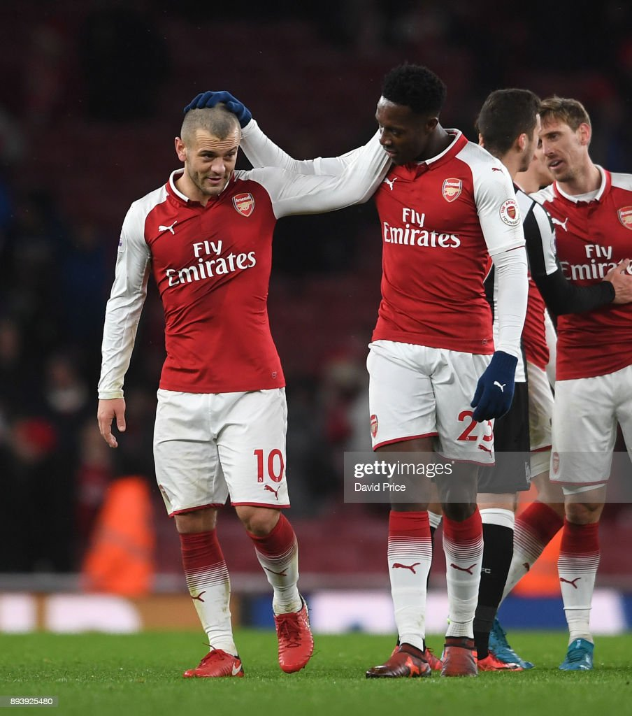 Danny Welbeck and Jack Wilshere of Arsenal after the Premier League match between Arsenal and Newcastle United at Emirates Stadium on December 16, 2017 in London, England.