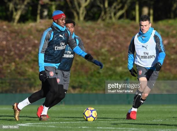 Danny Welbeck and Laurent Koscielny of Arsenal during a training session at London Colney on December 9 2017 in St Albans England