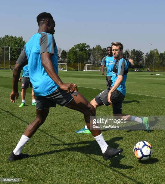 Danny Welbeck and Nacho Monreal of Arsenal during a training session at London Colney on May 8 2018 in St Albans England