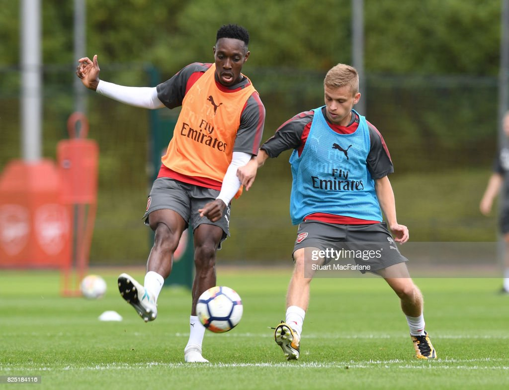 Danny Welbeck and Nathan Tormey of Arsenal during a training session at London Colney on August 1, 2017 in St Albans, England.