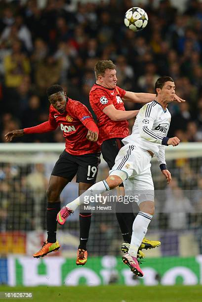 Danny Welbeck and Phil Jones of Manchester United go up for a header with Cristiano Ronaldo of Real Madrid during the UEFA Champions League Round of...