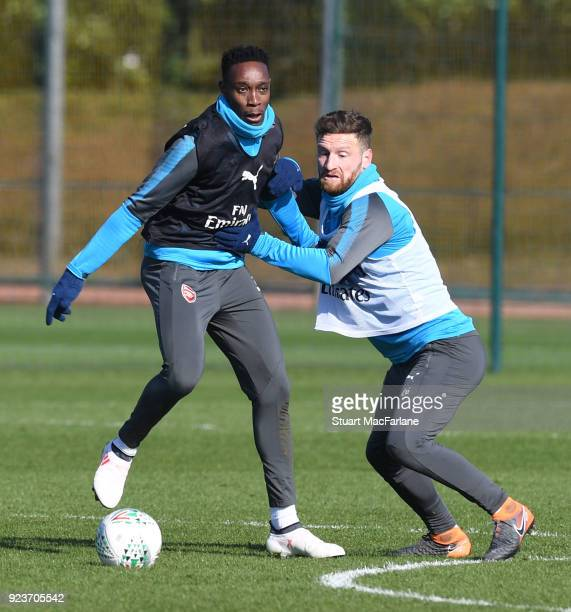 Danny Welbeck and Shkodran Mustafi of Arsenal during a training session at London Colney on February 24 2018 in St Albans England