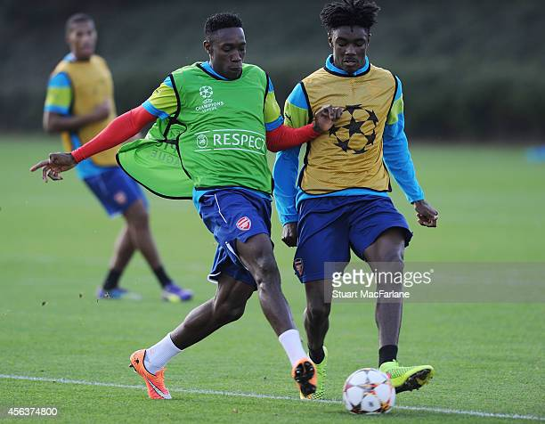 Danny Welbeck and Stefan O'Connor of Arsenal during a training session at London Colney on September 30 2014 in St Albans England