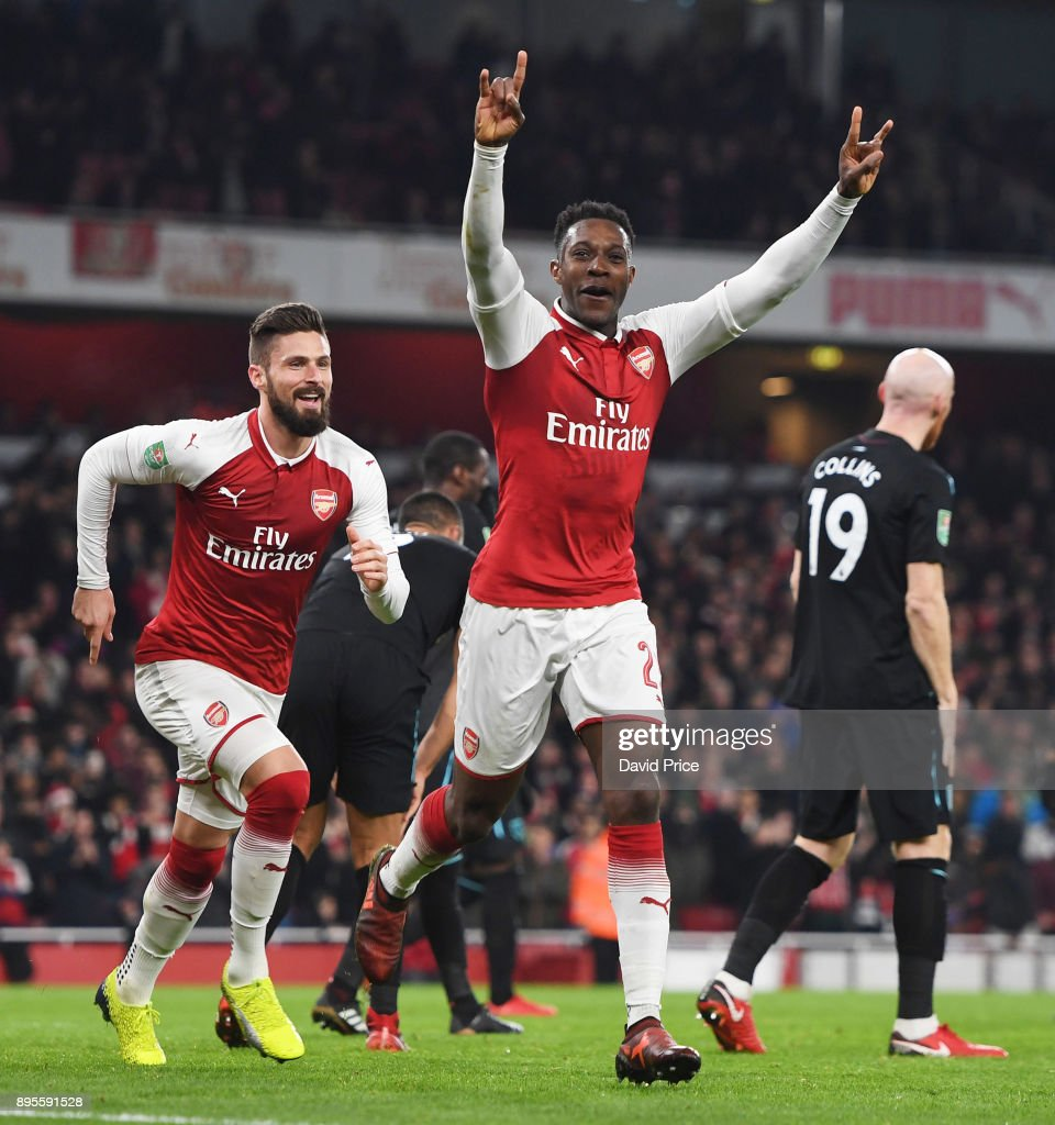 Danny Welbeck celebrates scoring a goal for Arsenal with Olivier Giroud during the Carabao Cup Quarter Final match between Arsenal and West Ham United at Emirates Stadium on December 19, 2017 in London, England.