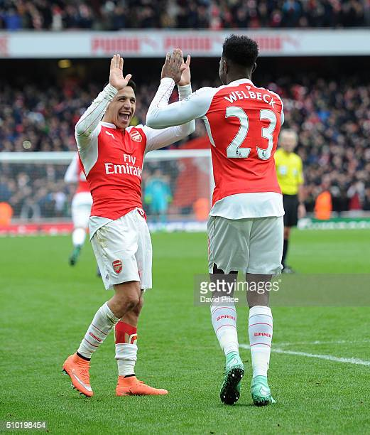 Danny Welbeck celebrates scoring Arsenal's 2nd goal with Alexis Sanchez during the Barclays Premier League match between Arsenal and Leicester City...