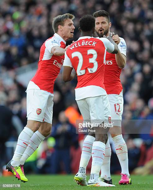Danny Welbeck celebrates scoring Arsenal's goal with Olivier Giroud and Nacho Monreal of Arsenal during the Barclays Premier League match between...
