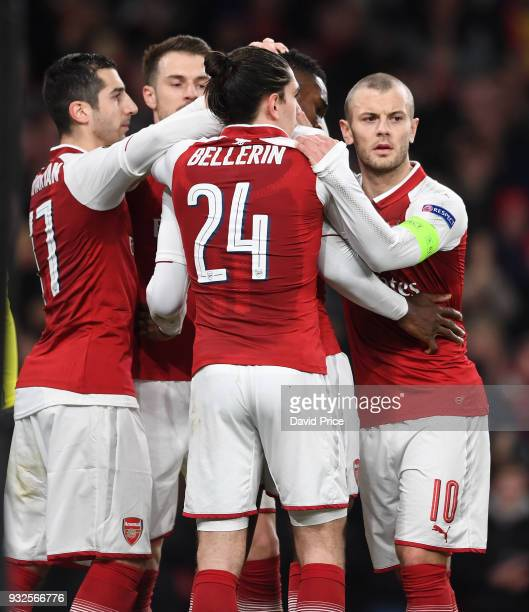Danny Welbeck celebrates scoring his and Arsenal's 1st goal from the penalty spot with Henrikh Mkhitaryan and Jack Wilshere during the match between...