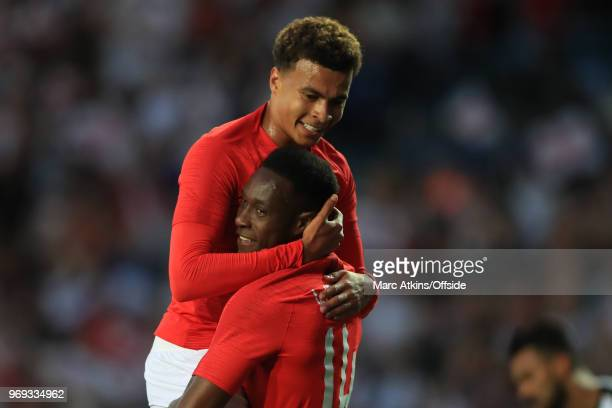 Danny Welbeck celebrates scoring his goal with Deli Alli during the International Friendly match between England and Costa Rica at Elland Road on...