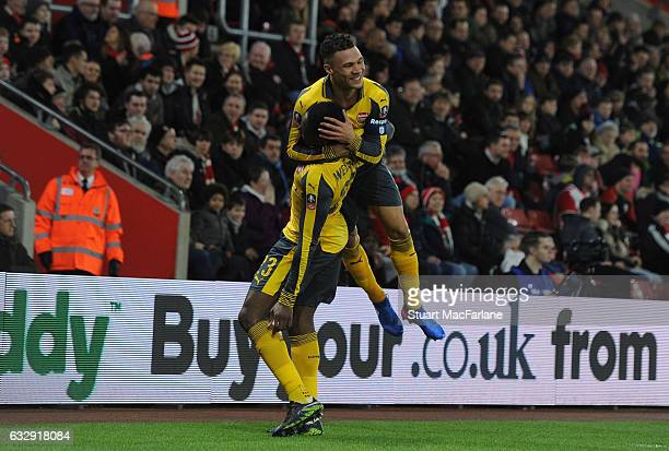 Danny Welbeck celebrates scoring the 1st Arsenal goal with Kieran Gibbs during the Emirates FA Cup Fourth Round match between Southampton and Arsenal...
