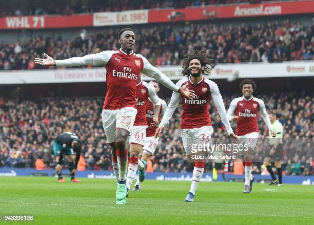 Danny Welbeck celebrates scoring the 1st Arsenal goal with Mo Elneny during the Premier League match between Arsenal and Southampton at Emirates...