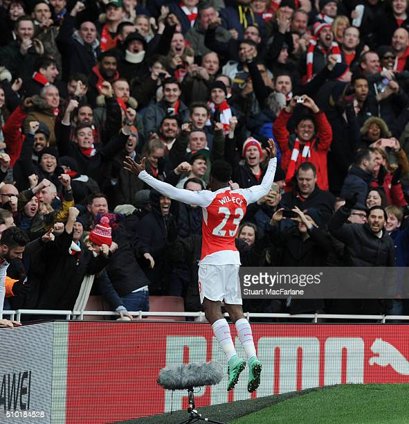 Danny Welbeck celebrates scoring the 2d goal with the Arsenal fans during the Barclays Premier League match between Arsenal and Leicester City at...