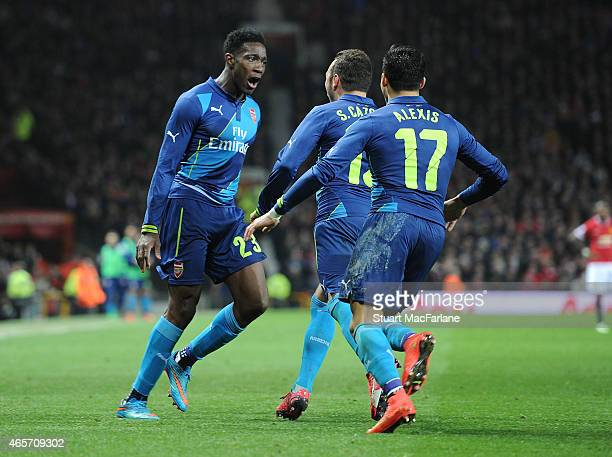 Danny Welbeck celebrates scoring the 2nd Arsenal goal with Alexis Sanchez and Santi Cazorla during the FA Cup Quarter Final between Manchester United...