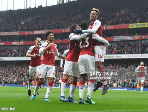 Danny Welbeck celebrates scoring the 2nd Arsenal goal with PierreEmerick Aubameyang and Mo Elneny during the Premier League match between Arsenal and...