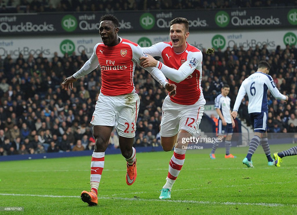 Danny Welbeck celebrates scoring the opening goal for Arsenal with Olivier Giroud during the match between West Bromwich Albion and Arsenal in the Barclays Premier League at The Hawthorns on November 29, 2014 in West Bromwich, England.
