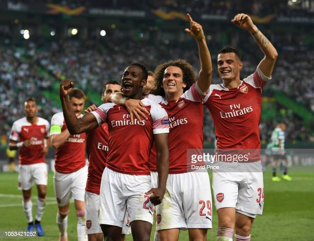 Danny Welbeck celebrats scoring Arsenal's goal with Matteo Guendouzi and Granit Xhaka during the UEFA Europa League Group E match between Sporting CP...