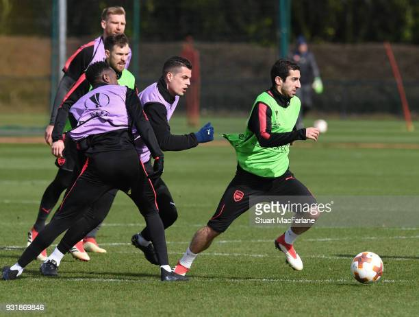 Danny Welbeck Granit Xhaka and Henrikh Mkhitaryan of Arsenal during a training session at London Colney on March 14 2018 in St Albans England