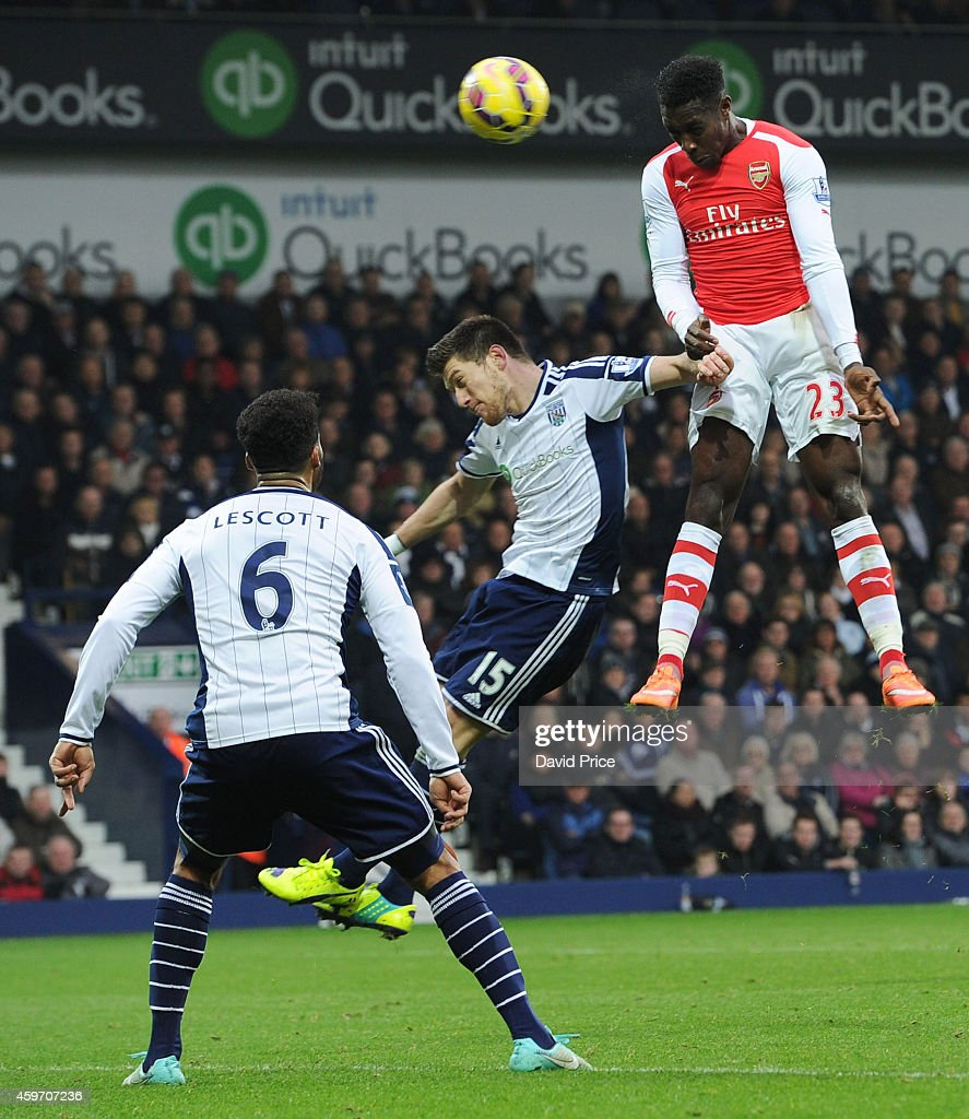 Danny Welbeck heads Arsenal's goal under pressure from Sebastien Pocognoli of WBA during the match between West Bromwich Albion and Arsenal in the Barclays Premier League at The Hawthorns on November 29, 2014 in West Bromwich, England.