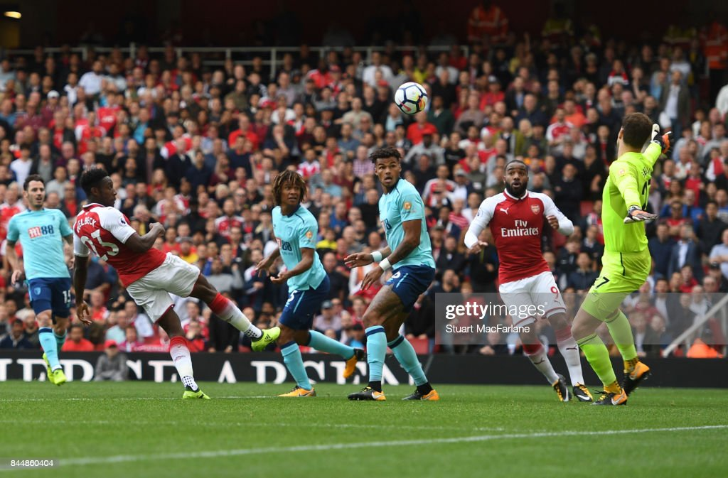 Danny Welbeck heads past Bournemouth goalkeeper Asmir Begovic to score for Arsenal during the Premier League match between Arsenal and AFC Bournemouth at Emirates Stadium on September 9, 2017 in London, England.