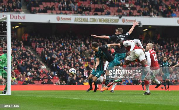 Danny Welbeck heads past Southampton goalkeeper Alex McCarthy to score the 3rd Arsenal goal during the Premier League match between Arsenal and...