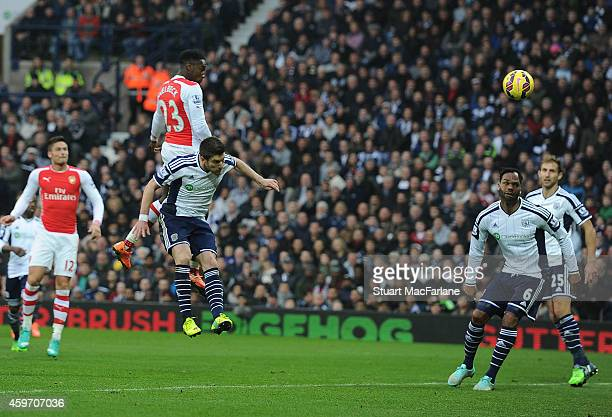 Danny Welbeck heads past West Brom goalkeeper Ben Foster to score for Arsenal during the Barclays Premier League match between West Bromwich Albion...