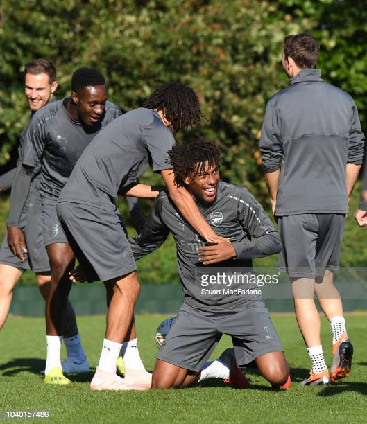 Danny Welbeck Mo Elneny and Alex Iwobi of Arsenal during a training session at London Colney on September 25 2018 in St Albans England