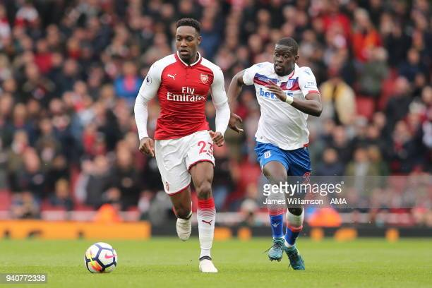 Danny Welbeck of Arsenal and Badou Ndiaye of Stoke City during the Premier League match between Arsenal and Stoke City at Emirates Stadium on April 1...