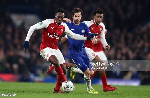 Danny Welbeck of Arsenal and Cesc Fabregas of Chelsea during the Carabao Cup SemiFinal First Leg match between Chelsea and Arsenal at Stamford Bridge...