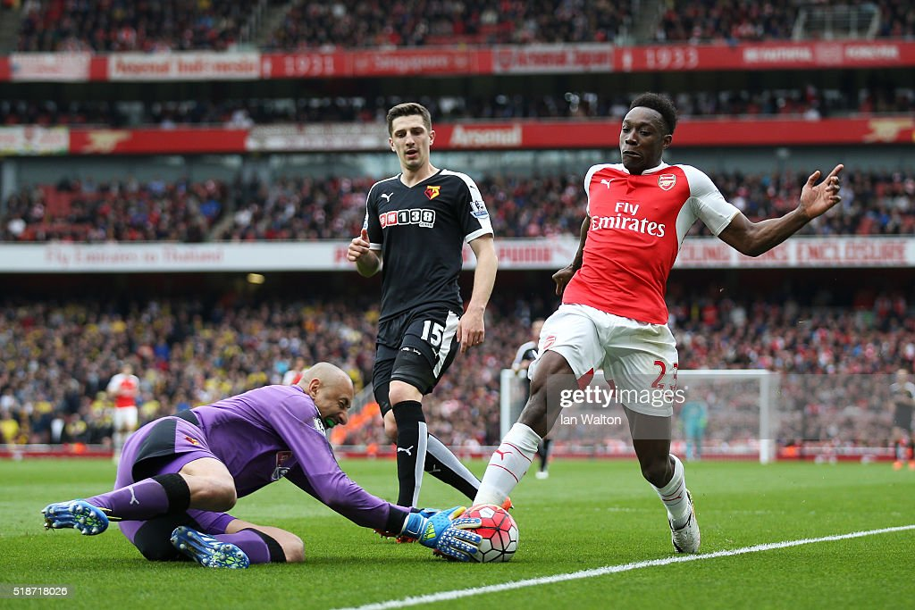 Danny Welbeck of Arsenal and Heurelho Gomes of Watford compete for the ball during the Barclays Premier League match between Arsenal and Watford at Emirates Stadium on April 2, 2016 in London, England.