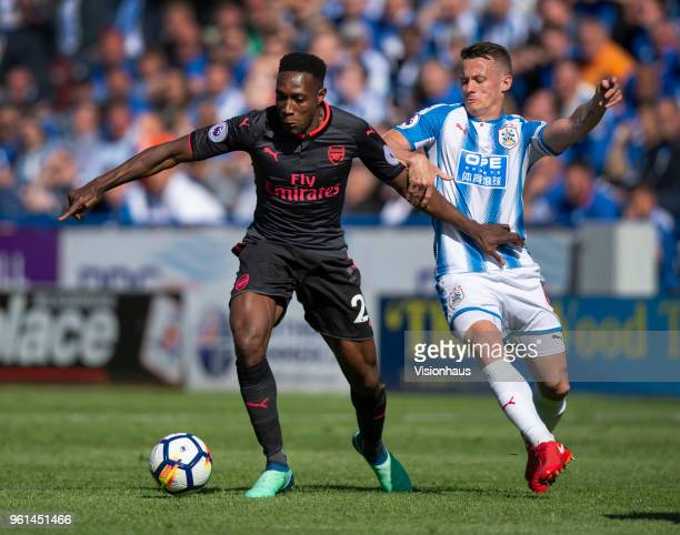 Danny Welbeck of Arsenal and Jonathan Hogg of Huddersfield Town in action the Premier League match between Huddersfield Town and Arsenal at John...