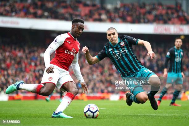 Danny Welbeck of Arsenal and Oriol Romeu of Southampton in action during the Premier League match between Arsenal and Southampton at Emirates Stadium...