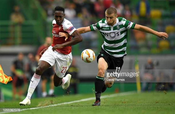 Danny Welbeck of Arsenal and Stefan Ristovski of Sporting CP clash during the UEFA Europa League Group E match between Sporting CP and Arsenal at...